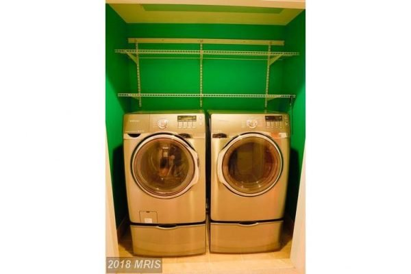 Front loading washer and dryer on pedestals